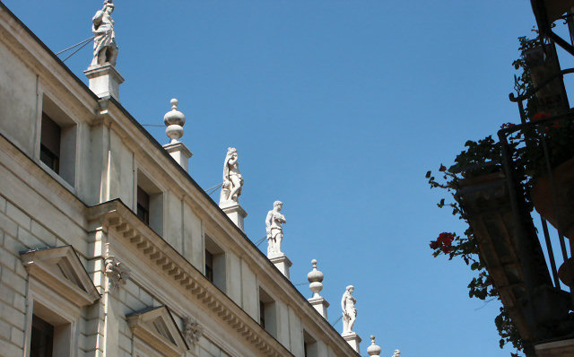 Statues atop the chamber of commerce in Vicenza